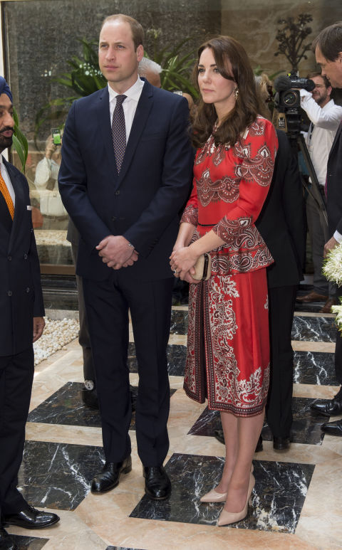 A red Alexander McQueen creation worn by Kate Middleton, the Duchess of Cambridge at her first appearance in her India trip with the Duke.
