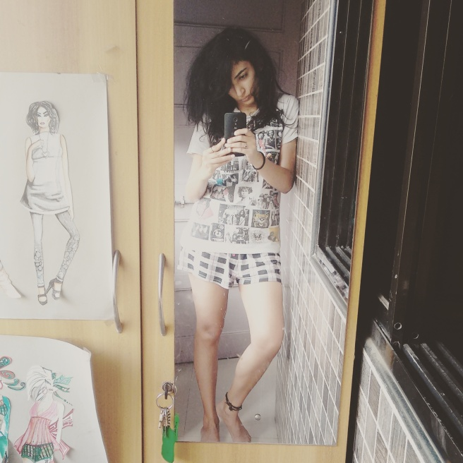 Shivani Krishan is wearing black and white check shorts and a graphic printed t-shirt | Chai High | Indian Fashion Blog | Nightwear | Selfie