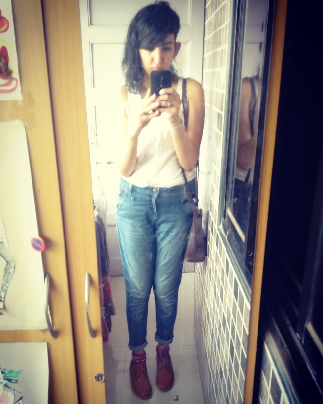 Shivani Krishan wearing blue jeans and a white sleeveless tucked in shirt with red Doc Martin boots | Chai High | Indian Fashion Blog | April 2016 | Mumbai | Curly long bob | Brown Holi Bag | Selfie