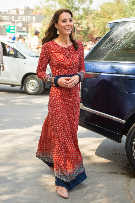 Kate Middleton wore a red and navy maxi dress on Day 3. The dress had full sleeves, a modest neckline and a front tie-up. I would love to wear this. Doesn't it look so comfy?