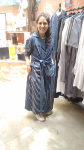 Pallavi Dhyani wearing her own creation from THREE at the Vintage Garden. Her collection is fabricated from cotton and linen and has plenty of stripes. She wears her THREE tie-up jacket with white sneakers.