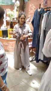 Pallavi Dhyani wearing her own creation from THREE at the Vintage Garden. Her collection is fabricated from cotton and linen and has plenty of stripes. She wears her THREE trenchcoat with white sneakers.