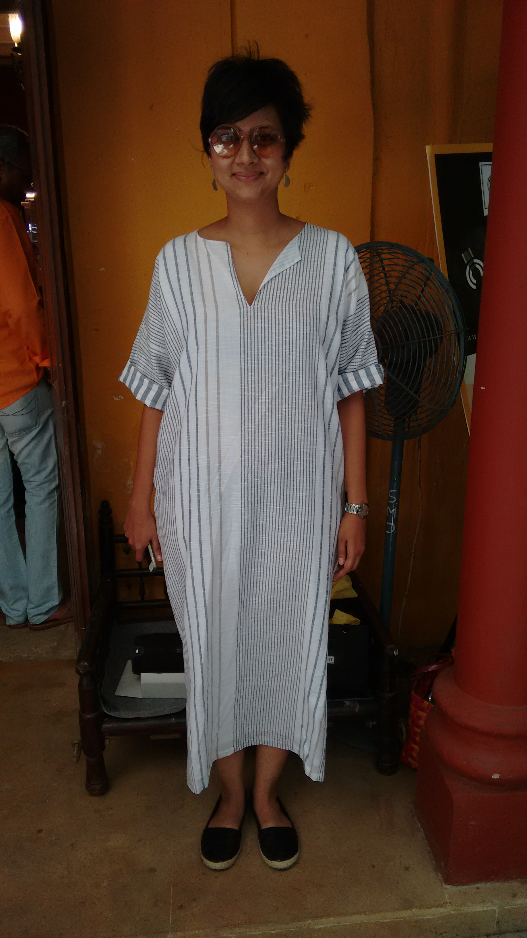 Mansi Kadne wears a long slit dress from THREE and geometric jewellery from her own label, at the Vintage Garden, Bandra, Mumbai.