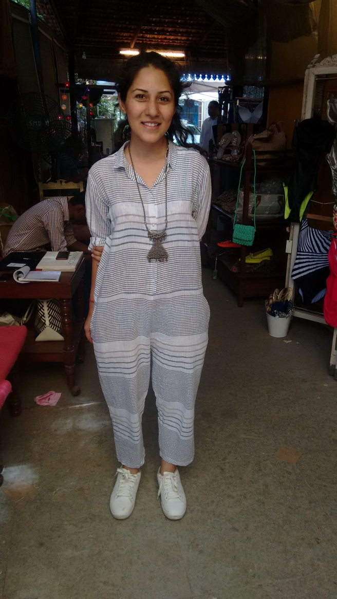 Pallavi Dhyani wearing her own creation from THREE at the Vintage Garden. Her collection is fabricated from cotton and linen and has plenty of stripes. She wears her THREE jumpsuit with white sneakers.