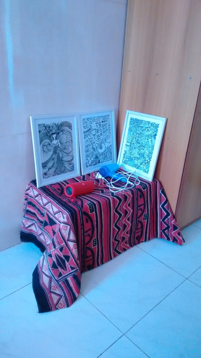 My framed sketches placed against a wall on a makeshift table of cardboard boxes and cloth | Chai High is an Indian Fashion Blog started by Shivani Krishan