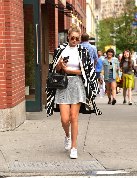 Gigi Hadid wears her white sneakers with a mini skirt | Chai High is an Indian Fashion Blog started by Shivani Krishan