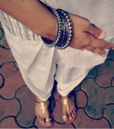 Wearing an ikat kurta with white salwar, golden kolhapuris and chunky silver bangles | Chai High is an Indian Fashion Blog started by Shivani Krishan